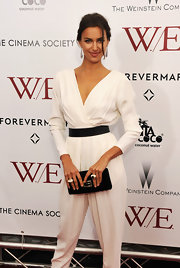 Irina Shayk kept her look simply chic, accessorizing with a black waist belt and matching clutch.