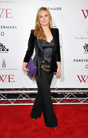 Julia Stiles embraced the menswear phenomenon in a black satin suit.