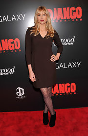 Lucy Punch completed her neutral ensemble with a pair of black ankle boots.