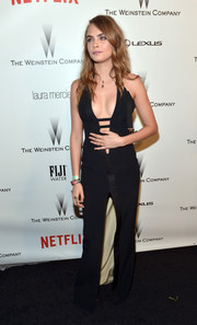 Cara Delevingne sent pulses racing at the Weinstein Company and Netflix Golden Globes party with this ultra-sexy Thierry Mugler dress, featuring a below-the-navel neckline with multiple cutouts.