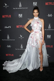 Shanina Shaik went for an ultra-girly vibe in a flowing, floral-embroidered gown by Ralph & Russo at the Weinstein Company Golden Globes party.
