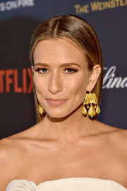 Renee Bargh opted for a straight, center-parted hairstyle when she attended the Weinstein Company and Netflix Golden Globe party.