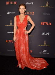 Nicky Whelan was trendy and glam in a red gown with waist cutouts and a long train at the Weinstein Company and Netflix Golden Globe party.