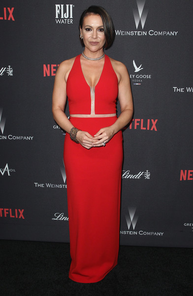 Alyssa Milano unleashed her vampy side at the Weinstein Company Golden Globes party in a red Alexander Wang gown boasting a plunging neckline and illusion seams.