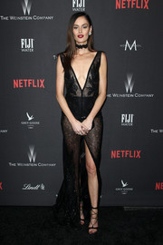 Nicole Trunfio caught plenty of stares at the Weinstein Company Golden Globes party in a sheer black gown by BERTA that showed plenty of skin with a plunging neckline and a high slit.