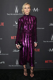 Diane Kruger looked disco-ready in a purple sequin-striped dress by Nina Ricci at the Weinstein Company Golden Globes party.
