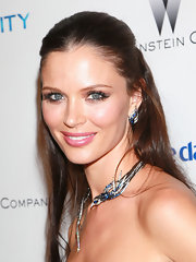 Georgina Chapman paired her sapphire bird collar necklace with matching diamond and earrings.