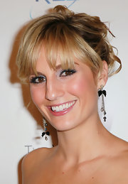 Alison paired her elegant updo with bow embellished chain earrings.