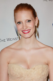 Jessica Chastain paired her bare neckline with gold and gemstone embellished earrings.