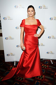 Catherine showed off her glamorous side in a vibrant red gown. She highlighted her dress with gold dangle earrings.