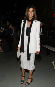 Carine Roitfeld added a masculine touch to her sexy low-cut top and skirt combo with a boxy white blazer during the Wes Gordon presentation.