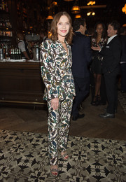 Isabelle Huppert teamed her suit with a pair of embellished platforms.