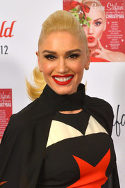 Gwen Stefani styled her hair into a flippy ponytail for the Westfield London Christmas lights switch on.