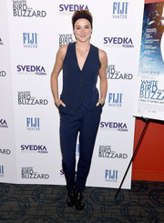 Shailene Woodley continued the menswear-inspired motif with black patent leather slip-ons by Miu Miu.