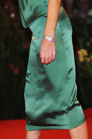 Isabelle Huppert accessorized with a luxurious diamond watch at the 'White Material' premiere.