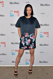 Eva Chen teamed her dress with modern-chic strappy sandals.