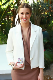 Whitney Port opted for a white blazer to pair with her dress while attending the Whitney Eve for Proper Attire launch.