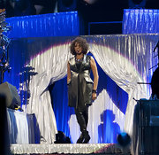 Whitney Houston wore a sleek leather coat as she performed on stage at the O2 World concert.