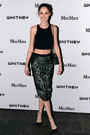 Nicole Trunfio chose a leopard print pencil skirt to add some print and texture to her simple and sleek look.