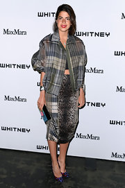 Leandra Medine mixed prints when she paired this zip-up plaid jacket with a leopard-print pencil skirt.