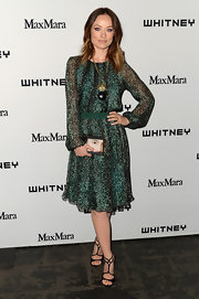 Olivia Wilde's printed dress had just a touch of boho chic to it with it's peasant-style sleeves and flowing skirt.