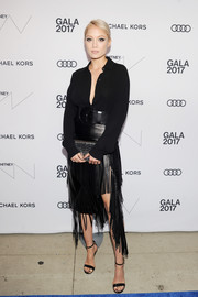 Pom Klementieff completed her all-black outfit with a pair of ankle-strap heels.