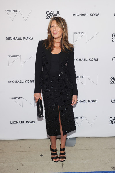 Nina Garcia styled her look with strappy black satin sandals.