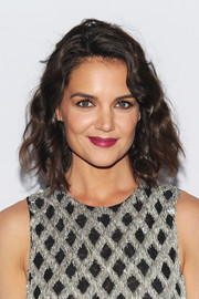 Katie Holmes amped up the girly vibe with a berry lip.