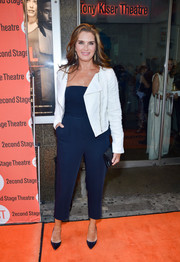 Brooke Shields teamed her jumpsuit with a white tweed moto jacket for a more stylish finish.