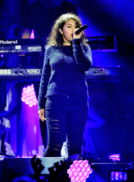 Alessia Cara performed during WiLD FM's Jingle Ball dressed down in a fuzzy sweater and ripped jeans.