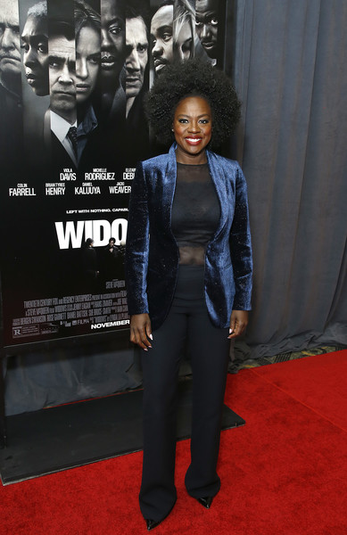 Viola Davis teamed black trousers with a sheer top for the special screening of 'Widows.'