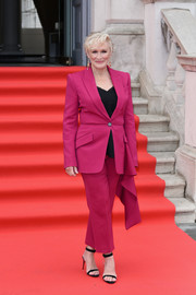 Glenn Close suited up in fuchsia Alexander McQueen for the UK premiere of 'The Wife.'