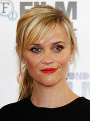 Reese Witherspoon's bright red lipstick popped at the 'Wild' photo call at the 58th BFI London Film Festival.