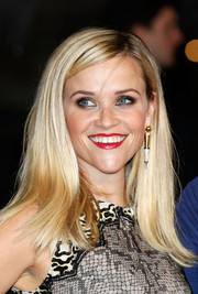 Reese Witherspoon added a hint of edge with dangling spike earrings by Jessica McCormack.