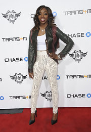 Estelle opted for skinny pants with a funky geometric design to add some spice to her red carpet look.