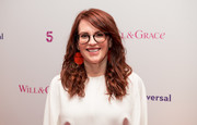 Megan Mullally accessorized with a funky pair of face-print earrings.