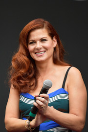 Debra Messing worked vintage-glam curls at the 'Will & Grace' ribbon cutting ceremony.