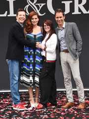 Megan Mullally was preppy in a white cardigan with red trim at the 'Will & Grace' ribbon cutting ceremony.
