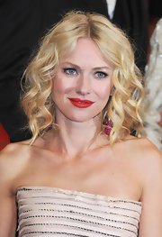 Actress Naomi Watts shined on the red carpet in Cannes. Her red lipstick popped, while her medium curls were the perfect finish.