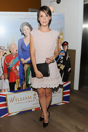 Alice St. Clair donned a pale pink dress for the screening of 'William & Catherine: A Royal Romance.' She paired the ruffled frock with black accessories.