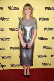 Judy Greer completed her look with a beaded black clutch.