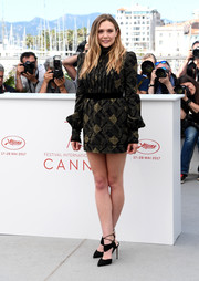 Elizabeth Olsen showed off her long legs in a printed mini dress by Marc Jacobs at the Cannes Film Festival photocall for 'Wind River.'