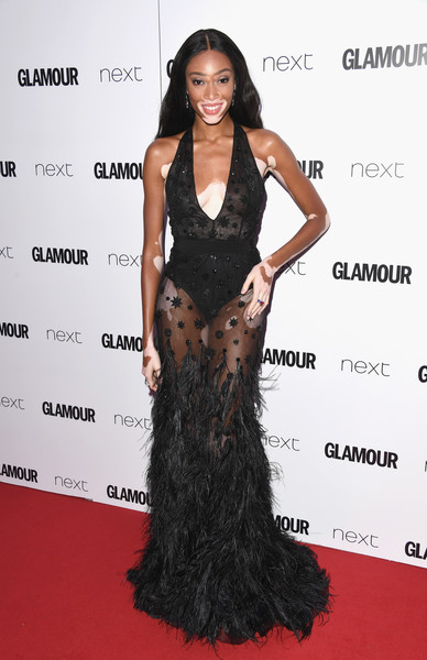 Winnie Harlow Sheer Dress [hair,clothing,dress,fashion model,long hair,hairstyle,gown,shoulder,carpet,red carpet,winnie harlow,glamour women of the year awards,awards,england,london,berkeley square gardens,red carpet arrivals,glamour women of the year]