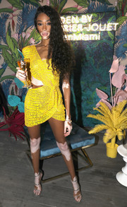 Winnie Harlow was bright and sexy in a yellow cutout mini dress by Julien Macdonald at the L'Eden by Perrier-Jouët party.