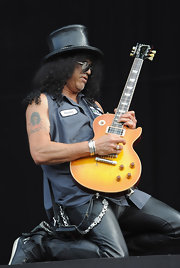 Slash showed off his portrait tattoo which he's had for many years.