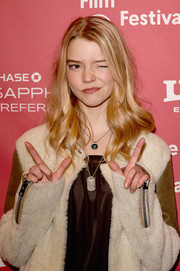 Anya Taylor-Joy styled her outfit with a silver dog tag necklace for the Sundance premiere of 'The Witch.'