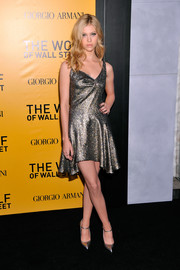 Nicola Peltz kept the shimmer going all the way down to her silver platform pumps.