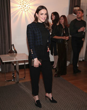 Elizabeth Henstridge dressed up her plain black top with a cropped tweed jacket for the Wolk Morais show.