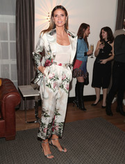 Heidi Klum polished off her look with strappy silver heels by Neil J. Rodgers.