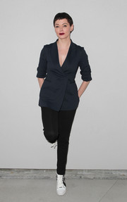 Rose McGowan suited up in a fitted navy jacket for the Wolk Morais debut fashion show.
